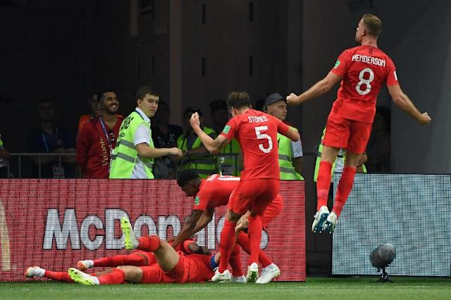 England players celebrate their second goal during the Russia 2018 World Cup Group G football match between Tunisia and England at the Volgograd Arena in Volgograd on June 18, 2018 (AFP Photo/Mark RALSTON)