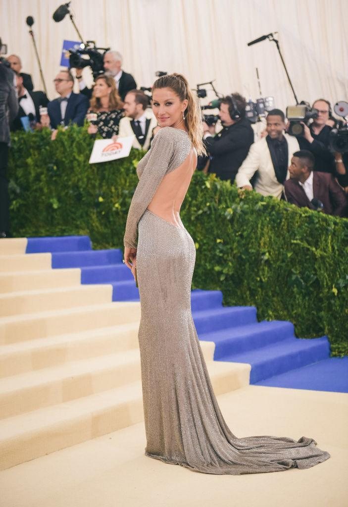 <p>Gisele made her own eco-statement by taking part in Livia Firth's Green Carpet Challenge, in this Stella McCartney bespoke gown she wore to the Met Ball. (Photo: Getty Images) </p>