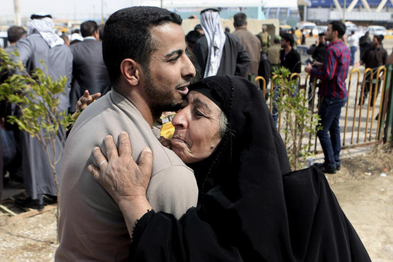 A former prisoner hugs his mother after being released from a prison in Baghdad, Iraq, Thursday, Feb. 28, 2013. Some 165 prisoners were released from the Iraqi Interior Ministry custody on Thursday. (AP Photo/ Karim Kadim)