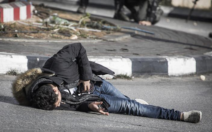 Israeli police troopers said was shot after he stabbed a member of their unit - Getty Images Europe