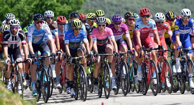 The pack of riders pedals during the 10th stage of the Giro d'Italia cycling race, from Penne to Gualdo Tadino d'Italia, Italy, Tuesday, May 15, 2018. (Daniel Dal Zennaro/ANSA via AP)