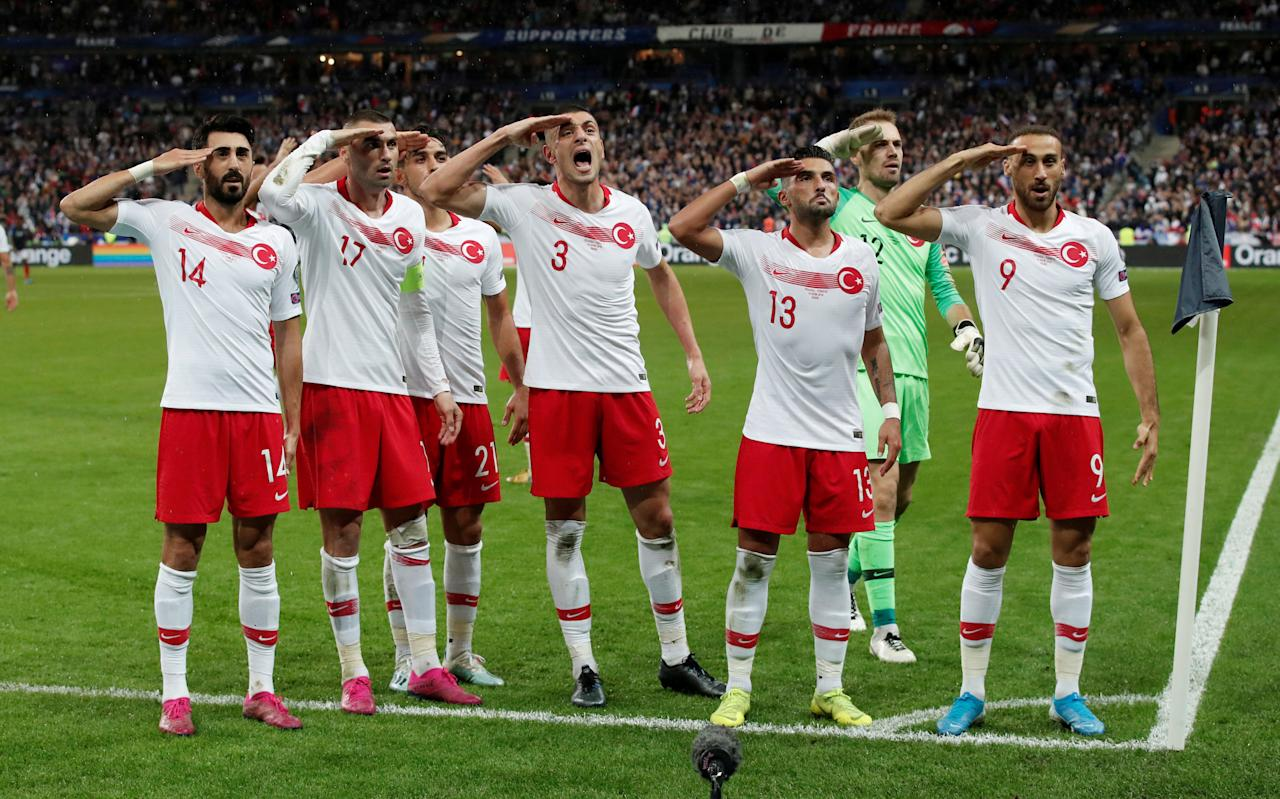 Soccer Football - Euro 2020 Qualifier - Group H - France v Turkey - Stade De France, Saint-Denis, France - October 14, 2019  Turkey players salute after Kaan Ayhan celebrates scoring their first goal  REUTERS/Benoit Tessier     TPX IMAGES OF THE DAY