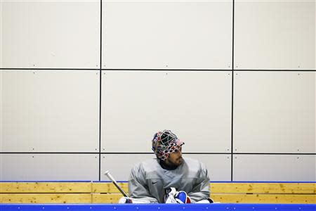 U.S. men's hockey team goaltender Miller sits on the bench during a team USA practice at the 2014 Sochi Winter Olympics