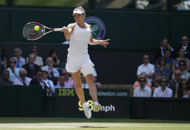 Simona Halep of Romania plays a return to Sabine Lisicki of Germany during their women's singles quarterfinal match at the All England Lawn Tennis Championships in Wimbledon, London, Wednesday, July 2, 2014. (AP Photo/Pavel Golovkin)