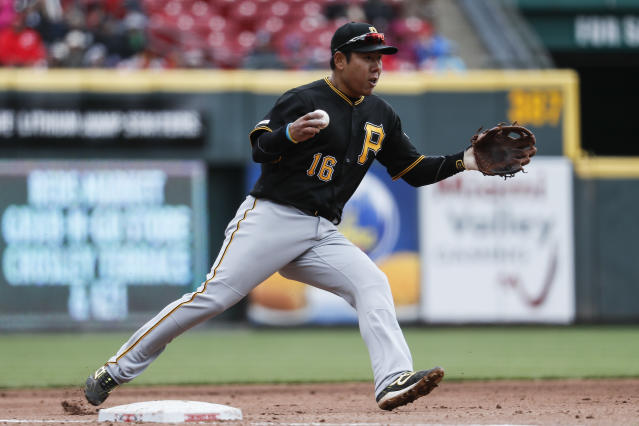 Pittsburgh Pirates shortstop Jung Ho Kang fields a single by Cincinnati Reds' Jose Iglesias in the sixth inning of a baseball game, Sunday, March 31, 2019, in Cincinnati. (AP Photo/John Minchillo)