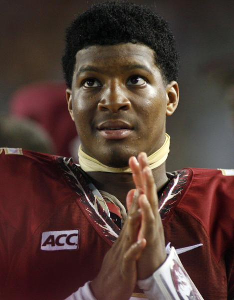 FILE - In this Sept. 21, 2013, file photo, Florida State quarterback Jameis Winston watches from the sidelines during the second half of an NCAA college football game against Bethune-Cookman in Tallahassee, Fla. Winston is under investigation in an alleged sexual assault reported nearly a nearly a year ago, the university and Winston's attorney confirmed on Wednesday, Nov. 13, 2013. (AP Photo/Phil Sears, File)
