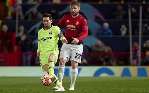 Luke Shaw of Manchester United competes for the ball with Lionel Messi of FC Barcelona during the UEFA Champions League Quarter Final first leg match between Manchester United and FC Barcelona - Credit: Getty images