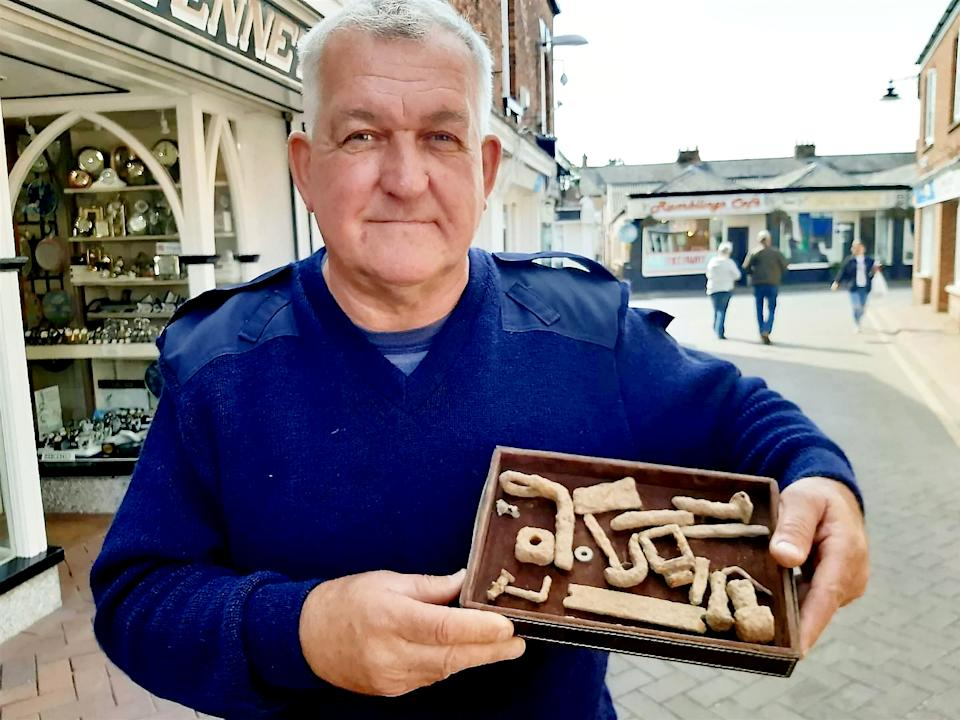 Raymond Kosschuk with some of the artefacts he found. (SWNS)