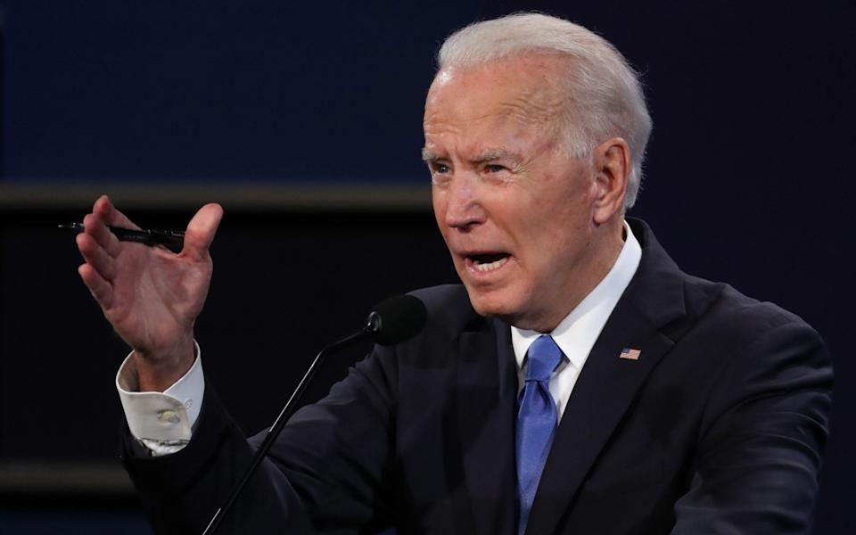 Democratic presidential nominee Joe Biden participates in the final presidential debate against U.S. President Donald Trump at Belmont University on October 22, 2020 in Nashville, Tennessee. This is the last debate between the two candidates before the election on November 3 - GETTY IMAGES