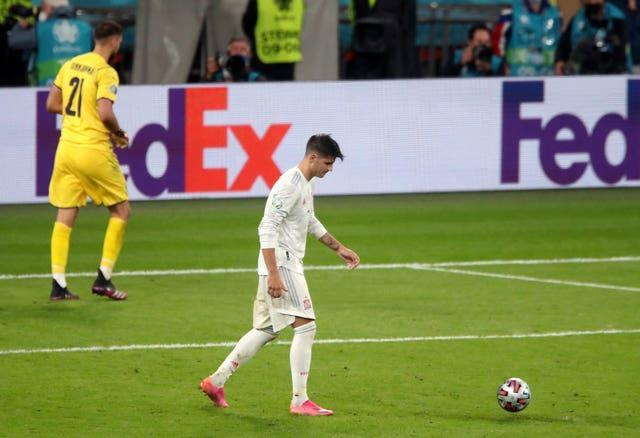 Alvaro Morata, right, reacts after his penalty was saved