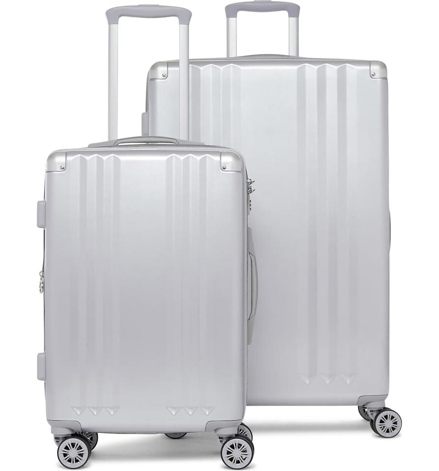 "<p>This <a href=""https://www.popsugar.com/buy/Calpak-Ambeur-2-Piece-Spinner-Luggage-Set-538698?p_name=Calpak%20Ambeur%202-Piece%20Spinner%20Luggage%20Set&retailer=shop.nordstrom.com&pid=538698&price=325&evar1=fab%3Aus&evar9=45654068&evar98=https%3A%2F%2Fwww.popsugar.com%2Fphoto-gallery%2F45654068%2Fimage%2F47089842%2FCalpak-Ambeur-2-Piece-Spinner-Luggage-Set&list1=shopping%2Ctravel%2Cbags%2Cluggage%2Csuitcases%2Ctravel%20style%2Cbest%20of%202020&prop13=api&pdata=1"" rel=""nofollow"" data-shoppable-link=""1"" target=""_blank"" class=""ga-track"" data-ga-category=""Related"" data-ga-label=""https://shop.nordstrom.com/s/calpak-ambeur-2-piece-spinner-luggage-set/4633739/full?origin=keywordsearch-personalizedsort&amp;breadcrumb=Home%2FAll%20Results&amp;color=silver"" data-ga-action=""In-Line Links"">Calpak Ambeur 2-Piece Spinner Luggage Set</a> ($325) will take you everywhere you need to go.</p>"