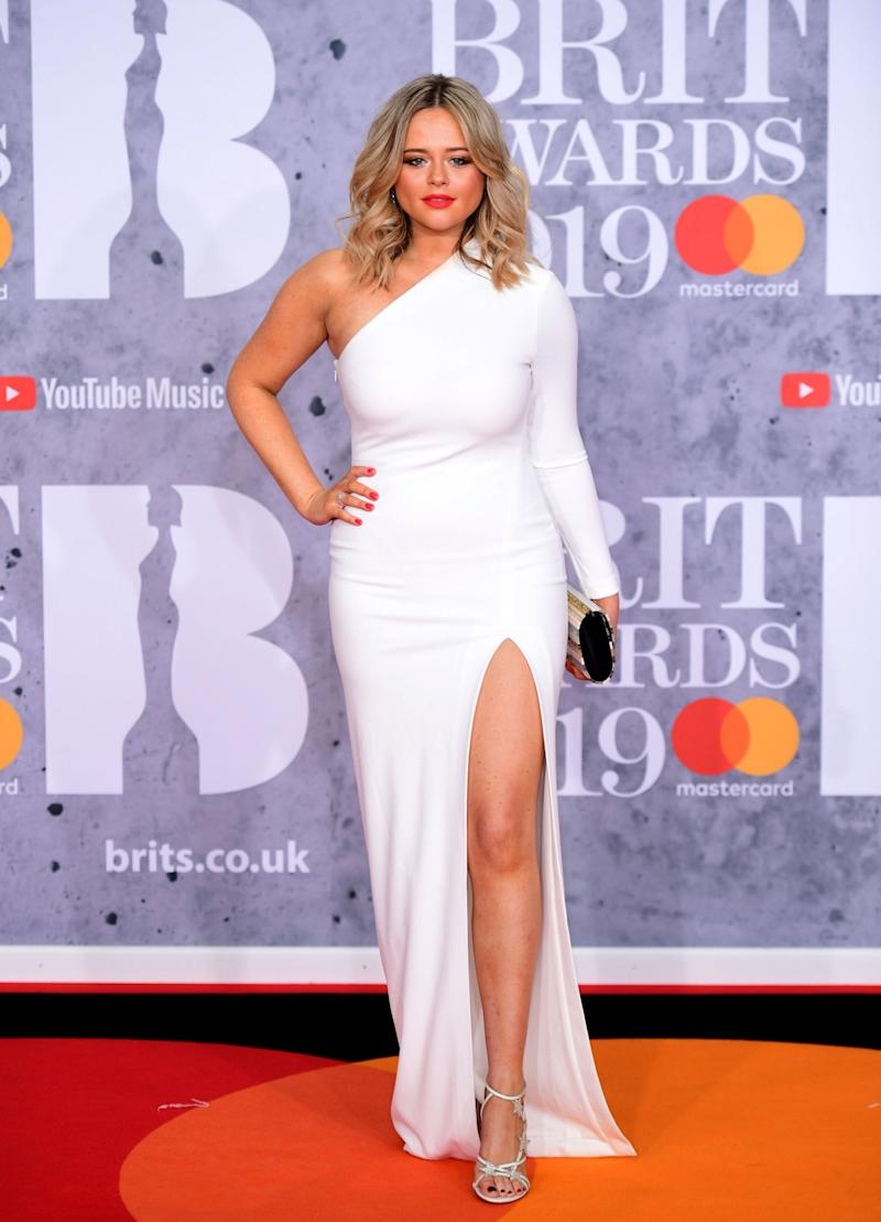 Radiant: Emily Atack wore a white dress with a thigh-high slit for the BRITs (Ian West/PA)