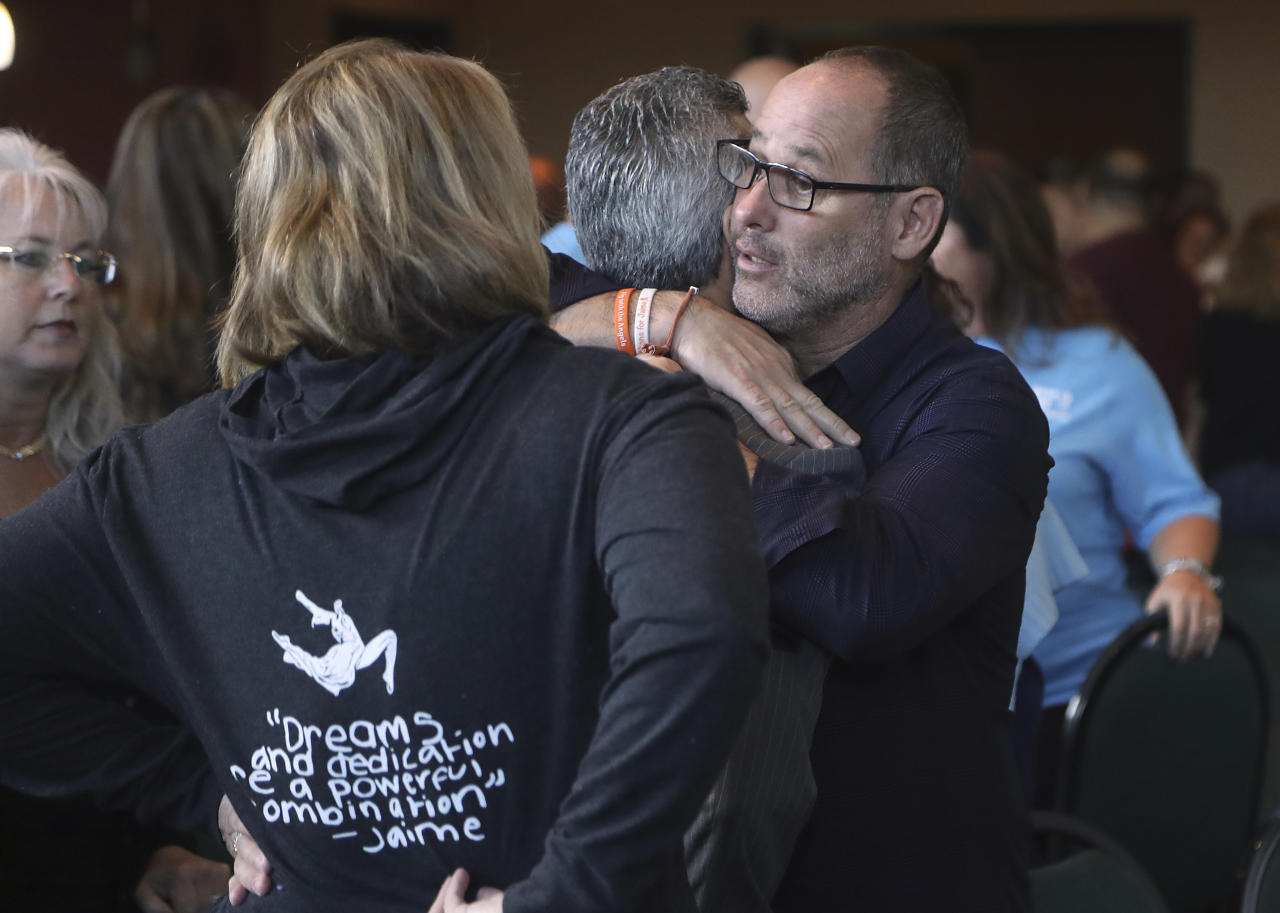 Fred Guttenberg, father of shooting victim Jaime Guttenberg and Max Schacter, the father of Alex hug during a break of the meeting of the Marjory Stoneman Douglas High School Public Safety Commission Thursday Nov 15, 2018, in Sunrise, Fla.)(Mike Stocker/South Florida Sun-Sentinel via AP, Pool