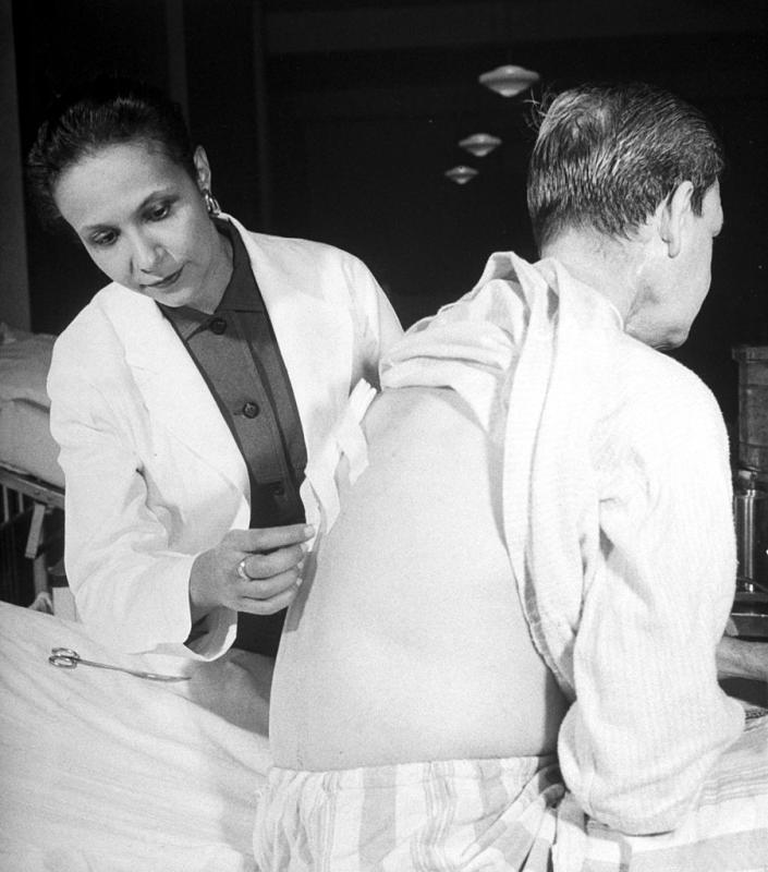 A photo in the Dec. 24, 1956, issue of LIFE magazine shows Dr. Jane Wright (L), head of cancer research, examining a patient at the Manhattan hospital Bellevue. | Margaret Bourke-White/The LIFE Picture Collection—Getty Images