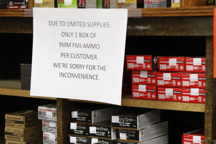 FILE - In this Wednesday, March 25, 2020, file photo, signs point out quantity limits on certain types of ammunition after Dukes Sport Shop reopened, in New Castle, Pa. After a year of pandemic lockdowns, mass shootings are back, but the guns never went away. As the U.S. inches toward a post-pandemic future, guns are arguably more present in the American psyche and more deeply embedded in American discourse than ever before. The past year's anxiety and loss fueled a rise in gun ownership across political and socio-economic lines. (AP Photo/Keith Srakocic, File)