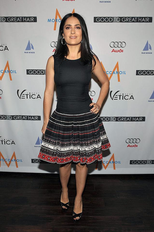 "Salma Hayek keeps things simple yet chic in a tight black tank, multi-colored striped skirt, and strappy heels. John Shearer/<a href=""http://www.gettyimages.com/"" target=""new"">GettyImages.com</a> - February 26, 2009"