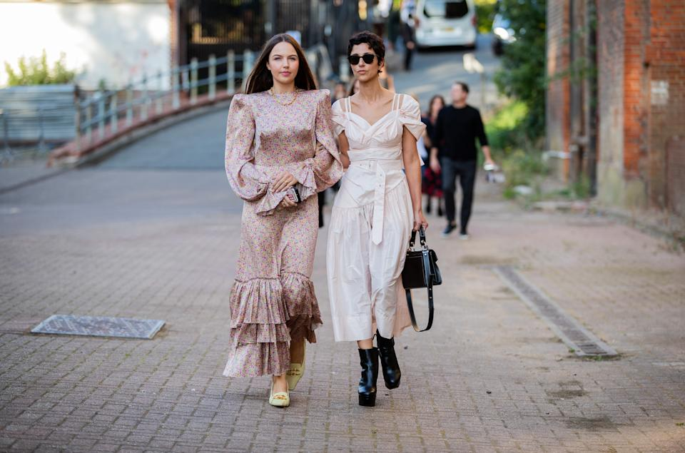 Yasmin Sewell (right) is seen wearing a white dress and black bag along with another stylish guest who wore The Vampire's Wife dress outside Simone Rocha. [Photo: Getty Images]