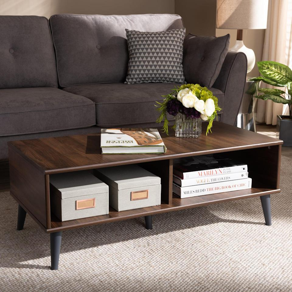 <p>Need extra storage? Get this <span>Baxton Studio Pierre Mid-Century Modern Coffee Table</span> ($91), which features two open shelf spaces for your magazines and organizers.</p>