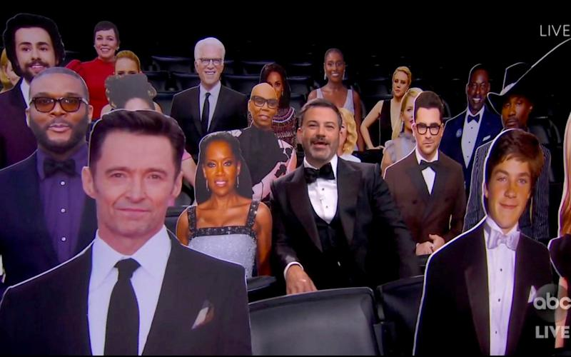 Host Jimmy Kimmel speaks surrounded by cardboard cutouts of actors in the audience during the 72nd Emmy Awards broadcast - The TV Academy and ABC Entertainment