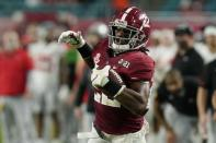 Alabama running back Najee Harris scores a touchdown against Ohio State during the first half of an NCAA College Football Playoff national championship game, Monday, Jan. 11, 2021, in Miami Gardens, Fla. (AP Photo/Chris O'Meara)