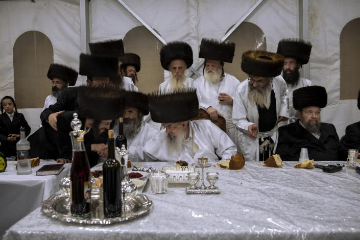"""Yaakov Tabersky, left, blessed by Haharon Biderman, the chief rabbi of the Lelov Hassidic dynasty, during the """"Pidyon Haben"""" ceremony for his son, Yossef, in Beit Shemesh, Israel, Thursday, Sept. 16, 2021. The Pidyon Haben, or redemption of the firstborn son, is a Jewish ceremony hearkening back to the biblical exodus from Egypt. (AP Photo/Oded Balilty)"""
