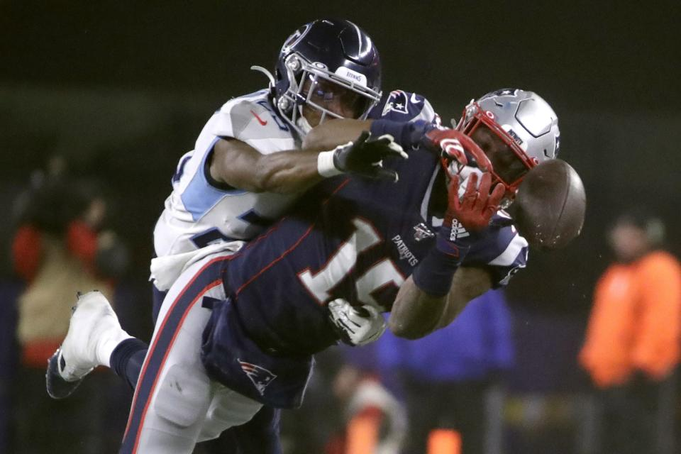 Tennessee Titans cornerback Adoree' Jackson, left, breaks up a pass intended for New England Patriots wide receiver N'Keal Harry in the second half of an NFL wild-card playoff football game, Saturday, Jan. 4, 2020, in Foxborough, Mass. (AP Photo/Elise Amendola)