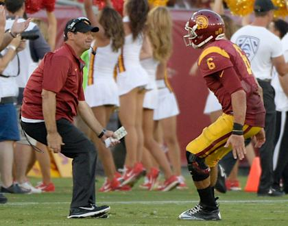 Steve Sarkisian celebrates a touchdown with Cody Kessler late in USC's win over Fresno State. (Getty)