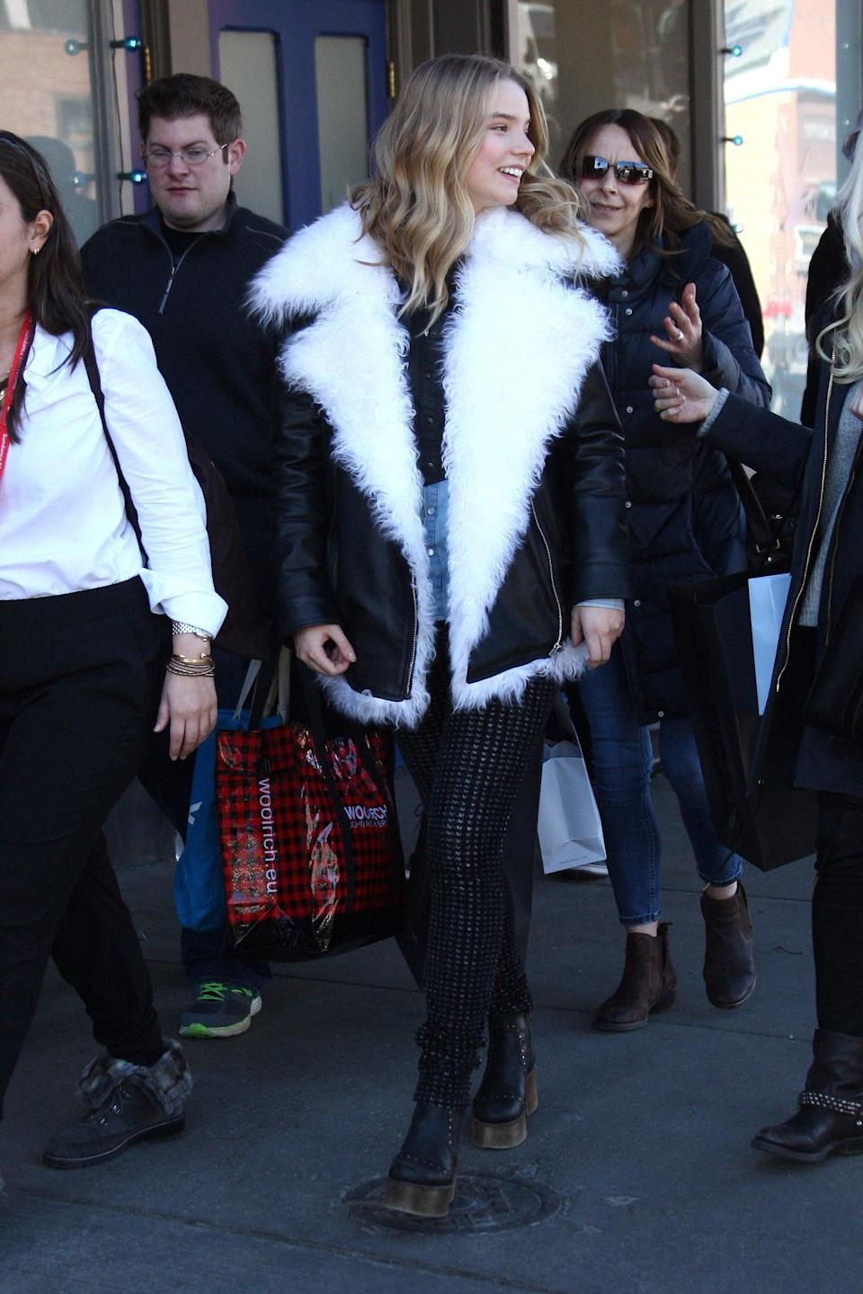 <p>Anya kept warm in Park City, Utah, sporting her oversize, shearling leather jacket with knit lettings and platform boots.</p>