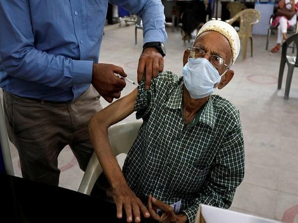 A resident receives a dose of coronavirus (COVID-19) vaccine, at a vaccination center in Karachi, Pakistan March 22, 2021. (Photo Credit: Reuters )