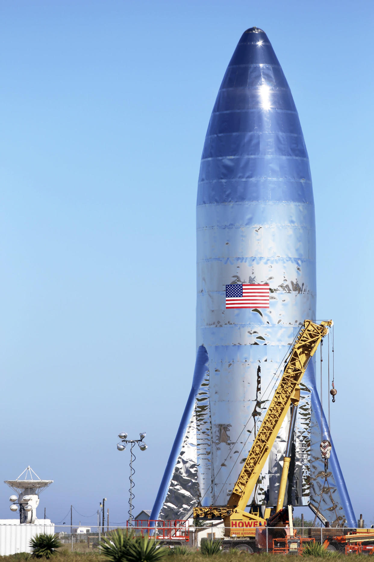 The SpaceX prototype Starship hopper stands at the Boca Chica Beach site in Texas