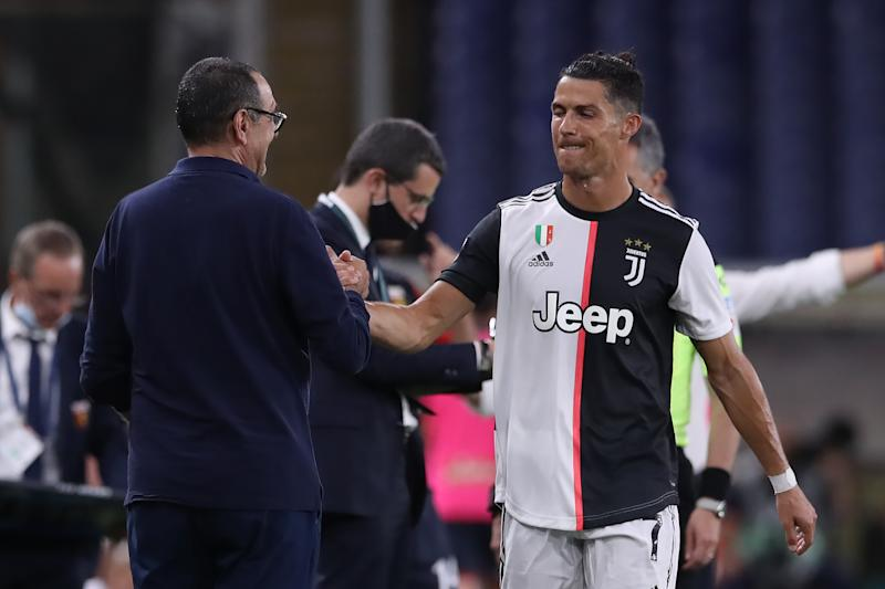 GENOA, ITALY - JUNE 30: Juventus's Italian Head coach Maurizio Sarri compliment Portuguese striker Cristiano Ronaldo as he is substituted during the Serie A match between Genoa CFC and Juventus at Stadio Luigi Ferraris on June 30, 2020 in Genoa, Italy. (Photo by Jonathan Moscrop/Getty Images)