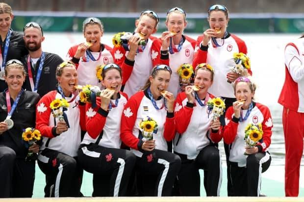 Canada's women's eight rowing crew poses with their gold medals during the medal ceremony at the Tokyo Olympics on Friday.  (Leon Neal/Getty Images - image credit)
