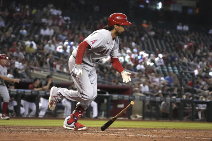 Los Angeles Angels' Anthony Rendon hits a two-run double against the Arizona Diamondbacks in the fifth inning during a baseball game, Saturday, June 12, 2021, in Phoenix. (AP Photo/Rick Scuteri)