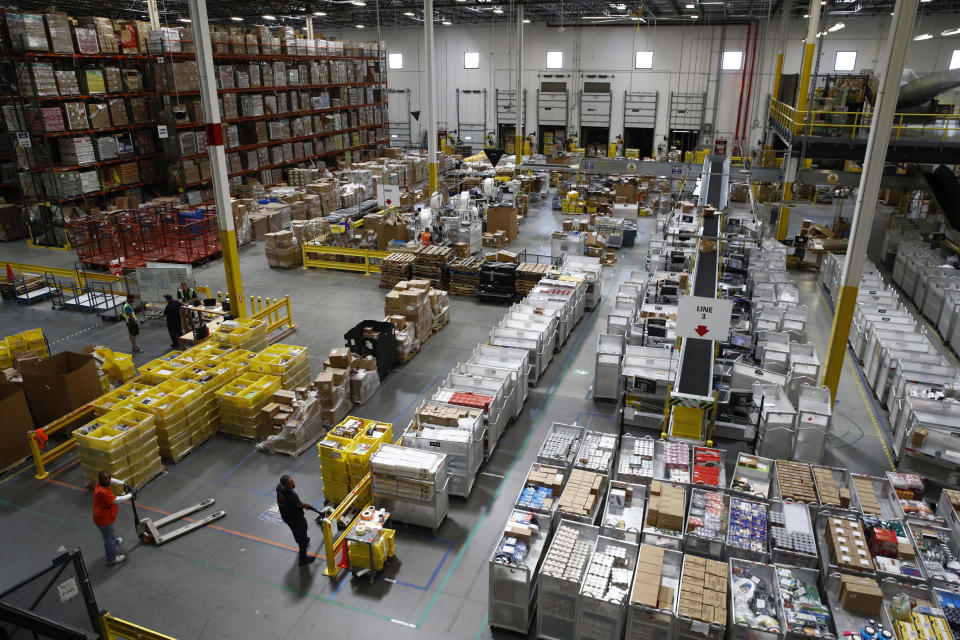 FILE- In this Aug. 3, 2017, file photo, workers prepare to move products at an Amazon fulfillment center in Baltimore. Amazon will spend more than $700 million to provide additional training to about one-third of its U.S. workforce. (AP Photo/Patrick Semansky, File)