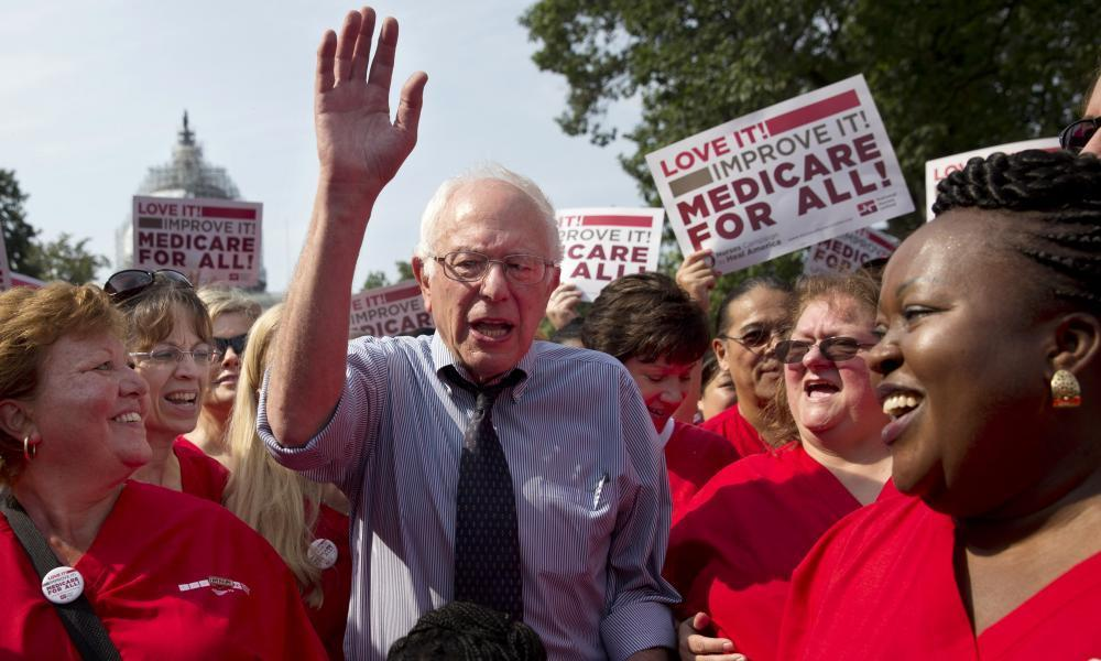 """<span class=""""element-image__caption"""">Bernie Sanders celebrates the 50th anniversary of Medicare and Medicaid two years ago.</span> <span class=""""element-image__credit"""">Photograph: Jacquelyn Martin/AP</span>"""