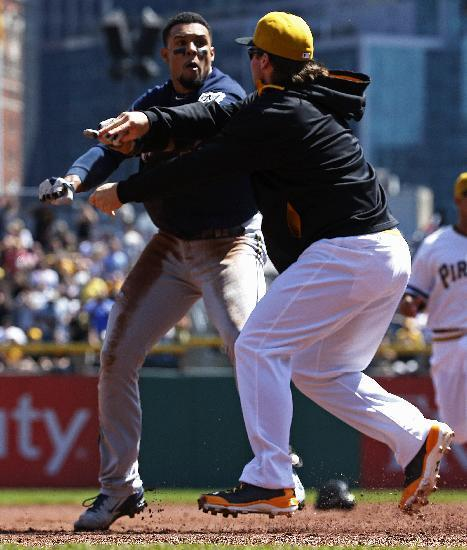 Pittsburgh Pirates' Travis Snider, right, takes down Milwaukee Brewers' Carlos Gomez during a skirmish between the teams during the third inning of a baseball game in Pittsburgh, Sunday, April 20, 2014. Gomez and Snider were ejected from the game. (AP Photo/Gene J. Puskar)