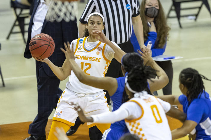 Tennessee guard Rae Burrell, top, looks to pass to guard Rennia Davis (0) during the first half of a college basketball game against Middle Tennessee State in the first round of the women's NCAA basketball tournament at the Frank Erwin Center in Austin, Texas, Sunday, March 21, 2021. (AP Photo/Stephen Spillman)