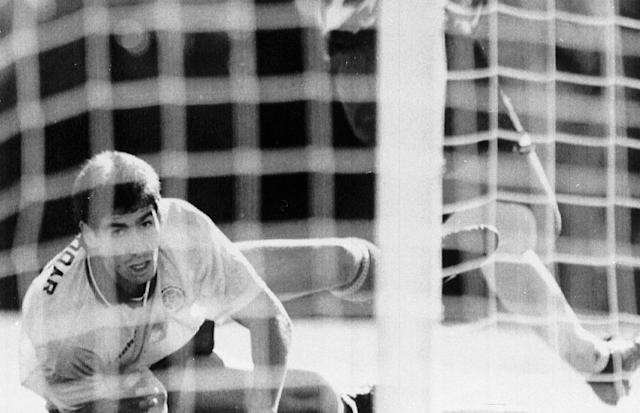 FILE - In this June 22, 1994 file photo, Colombia's Andres Escobar, lies on the ground during a World Cup soccer match against the United States in the Rose Bowl, Pasadena. The US defeated Colombia by 2-1, with Escobar scoring an own-goal. Just a few days later, Escobar was shot dead in his home town of Medellin. The 21st World Cup begins on Thursday, June 14, 2018, when host Russia takes on Saudi Arabia. (AP Photo/Eric Draper, File)