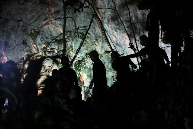 <p>Military personnel are seen in front of the Tham Luang cave where 12 boys and their soccer coach were trapped, in the northern province of Chiang Rai, Thailand, July 6, 2018. (Photo: Athit Perawongmetha/Reuters) </p>