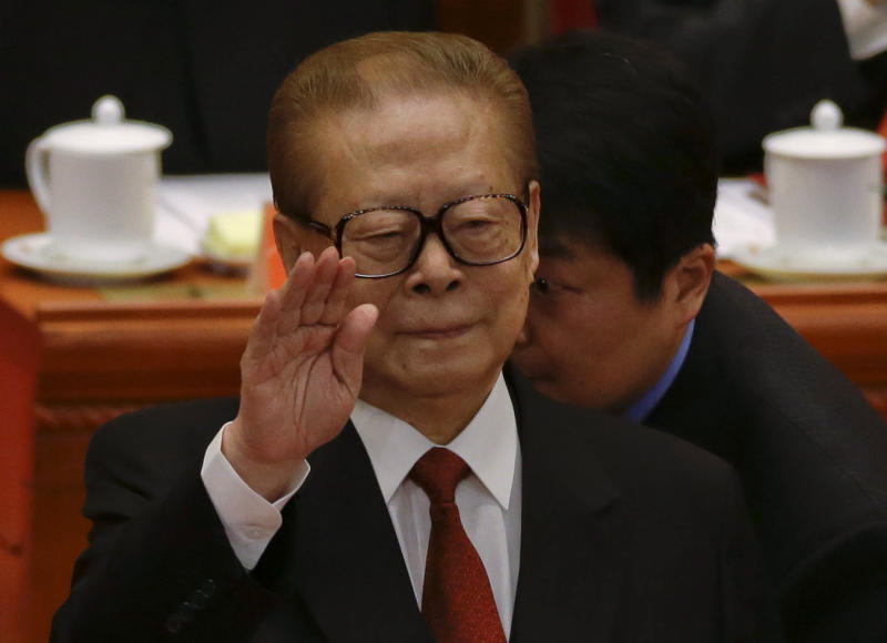 Former Chinese President Jiang Zemin gestures during the opening session of the 18th Communist Party Congress held at the Great Hall of the People in Beijing, China, Thursday, Nov. 8, 2012. (AP Photo/Ng Han Guan)