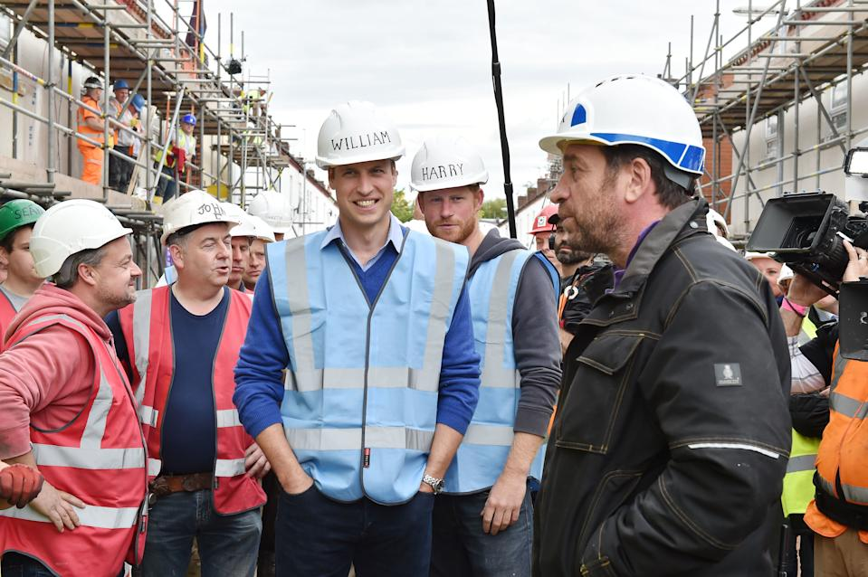 The Duke of Cambridge, Prince Harry and Nick Knowles during a visit to the BBC's DIY SOS Team for The Big Build: Veteran's Special at a street in Manchester.