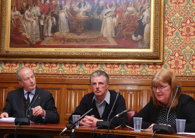Gilfoyle, with Lord Hunt (left) and his sister Susan Caddick during a press conference after he was released from prison (PA)