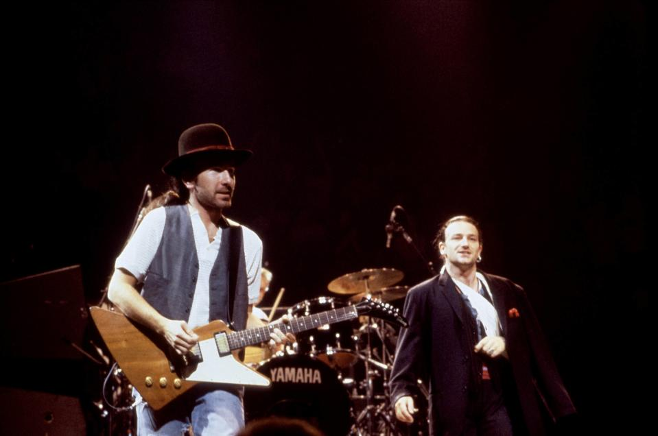 (MANDATORY CREDIT Ebet Roberts/Getty Images) UNITED STATES - SEPTEMBER 01: Photo of U2; The Edge & Bono performing live onstage on The Joshua Tree tour (Photo by Ebet Roberts/Redferns)