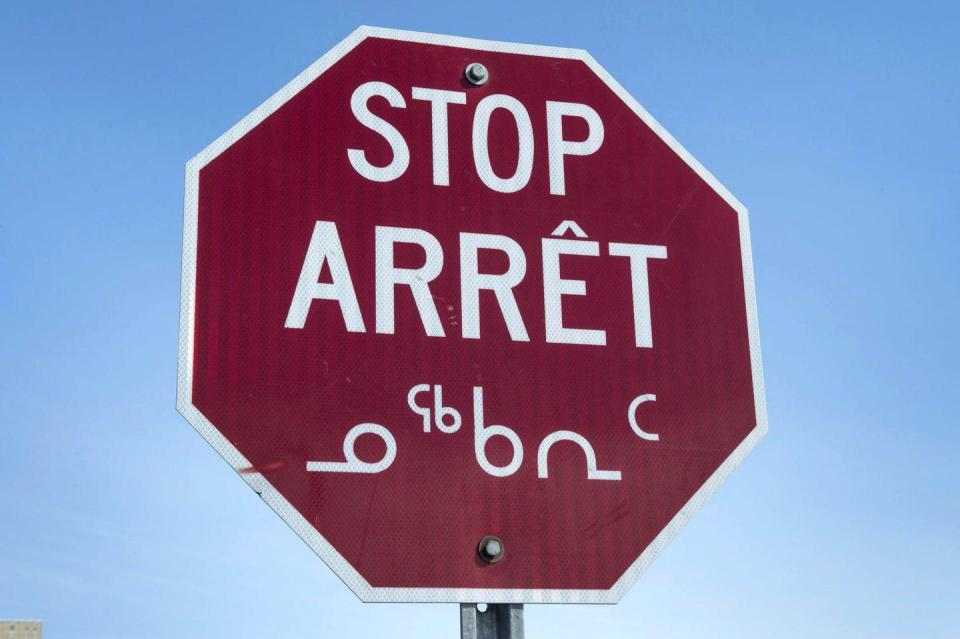 Stop sign reads STOP in english, french and Inuktitut