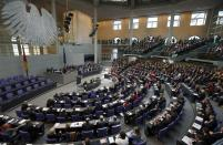 FILE - This Oct. 22, 2013 file photo shows a general view of the German Federal Parliament, Bundestag in Berlin, Germany. German voters elect a new parliament on Sunday, Sept. 26, 2021, a vote that will determine who succeeds Chancellor Angela Merkel after her 16 years in power. (AP Photo/Michael Sohn, file)