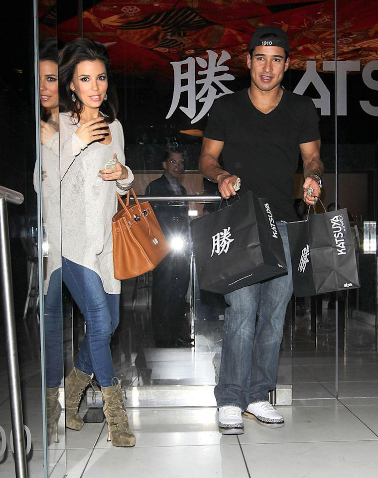 Eva Longoria and her longtime pal Mario Lopez made a stop by restaurant Katsuya in L.A. to pick up some Japanese food Tuesday night. With two bags of takeout, it's safe to assume they're bringing it home to share with their significant others: her beau, Eduardo Cruz, and his fiancee, Courtney Mazza. (1/31/2012)