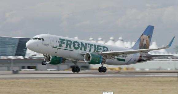 A Frontier Airlines plane landing on a runway