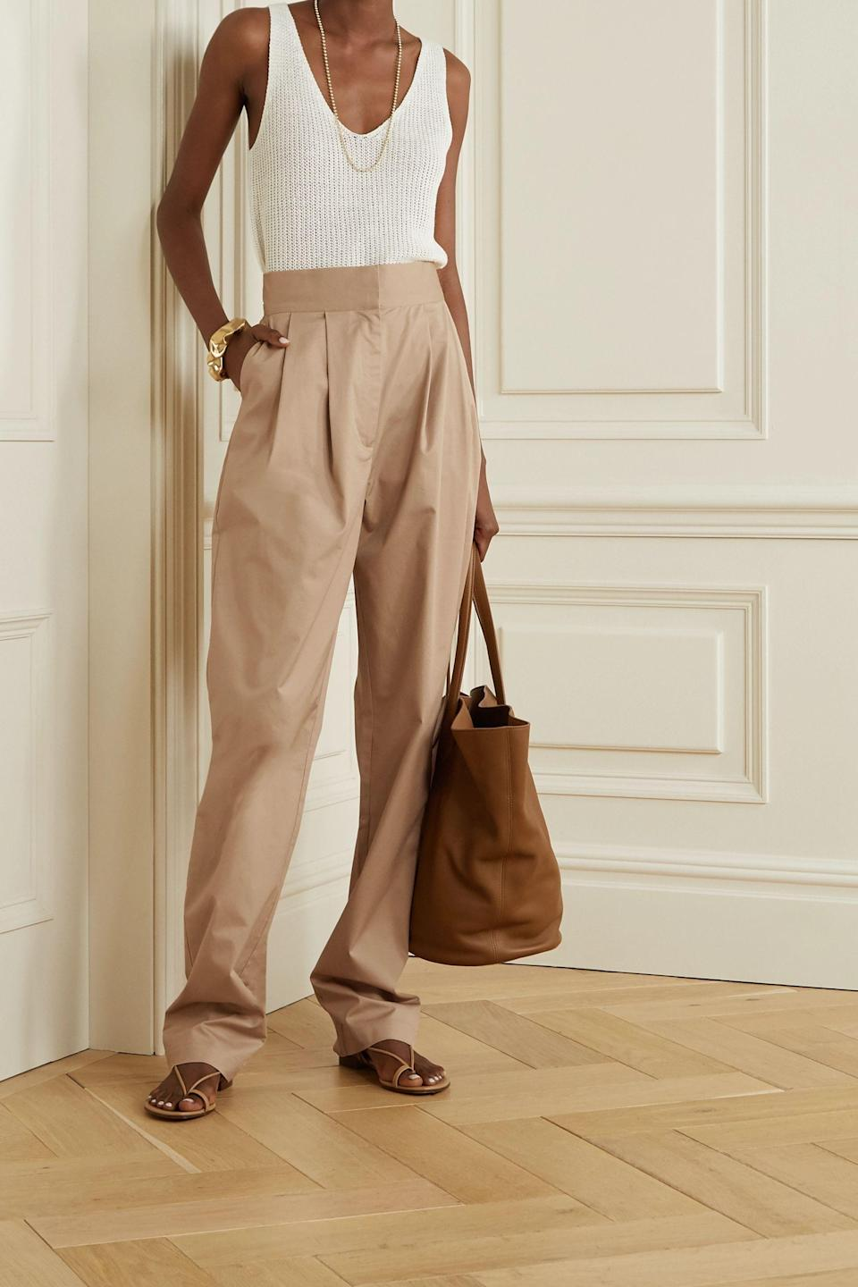 """<p><strong>TOVE</strong></p><p>net-a-porter.com</p><p><strong>$310.00</strong></p><p><a href=""""https://go.redirectingat.com?id=74968X1596630&url=https%3A%2F%2Fwww.net-a-porter.com%2Fen-us%2Fshop%2Fproduct%2Ftove%2Flourdes-stretch-cotton-twill-tapered-pants%2F1233164&sref=https%3A%2F%2Fwww.goodhousekeeping.com%2Fholidays%2Fthanksgiving-ideas%2Fg22728910%2Fthanksgiving-outfits%2F"""" rel=""""nofollow noopener"""" target=""""_blank"""" data-ylk=""""slk:Shop Now"""" class=""""link rapid-noclick-resp"""">Shop Now</a></p>"""