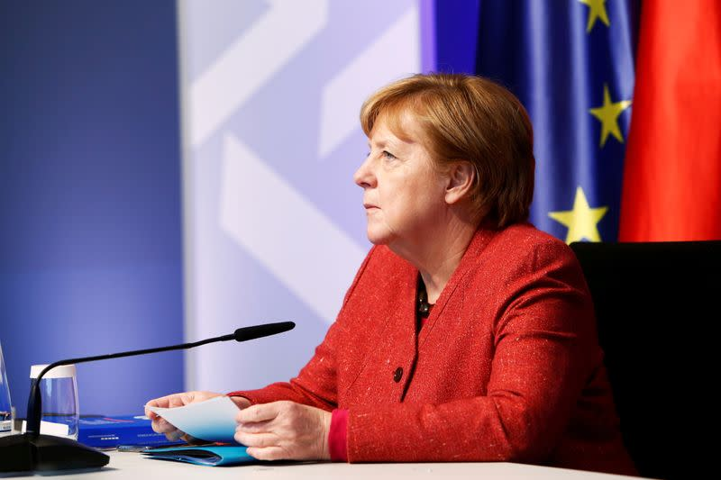 German Chancellor Angela Merkel receives the annual report of the five economic experts, in Berlin