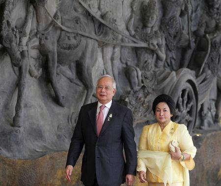 FILE PHOTO: Malaysia's PM Razak and wife Rosmah Mansor arrive at the Bali Nusa Dua Convention Center before the opening ceremony of the ASEAN Summit in Nusa Dua, Bali